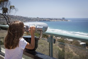 Young Girl Looking Out Over the Paci