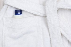 Flat Lay Bathrobe with Lotion in Poc