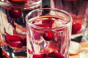Homemade cranberry vodka, dark woode