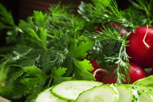 Slices of fresh cucumber, parsley, d