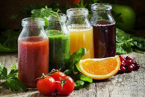 Bottles with fresh juices from fruit