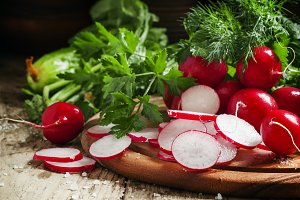 Slices of fresh radishes on a dark w