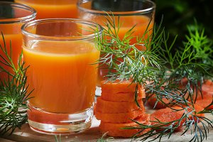 Freshly squeezed carrot juice in gla