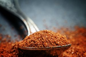 Ground sweet red paprika in a spoon