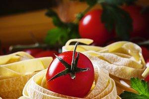 Assorted dry pasta, cherry tomatoes