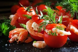 Red tomatoes stuffed with shrimp sal
