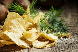 Salted potato chips with herbs on a
