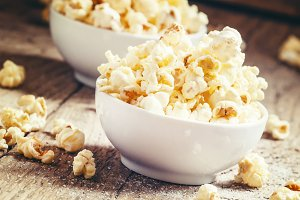 Sweet popcorn in white bowls, vintag
