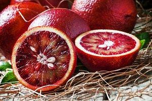 Bloody oranges, halved fruit, dry st