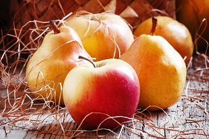 Ripe yellow and red apples and pears