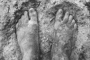 Pair of Feet in a Sand