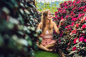 Young woman in a flower greenhouse