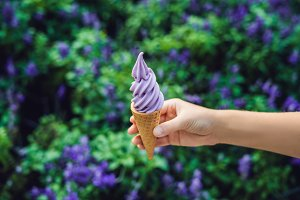 A female hand holds a lavender ice