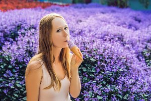 Young woman eats lavender ice cream