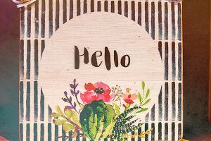 Hello text on a wooden plate.