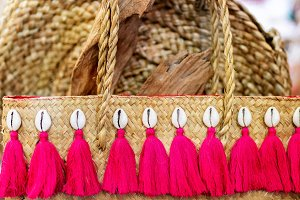 Straw bag on sale in the art shop of