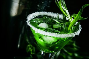 Green cocktail with tarragon and ice