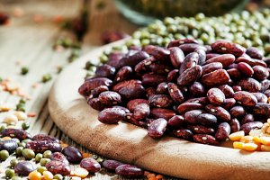 Dry purple beans, bean mix on plate,