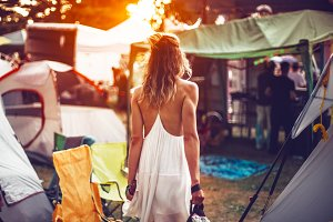 woman walking on festival camping