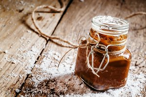 Salted caramel in a glass jar, selec