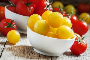 Red and yellow cherry tomatoes in a