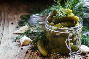 Pickled small cucumbers gherkins in