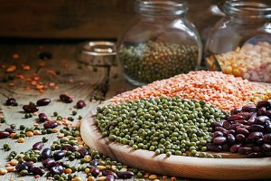 Green lentils on a vintage wooden ba