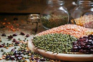 Green lentils on a vintage wooden ba