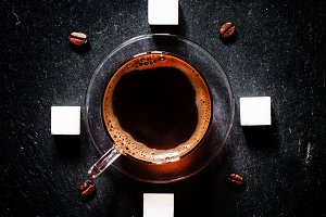 Cup of black coffee, coffee beans, w