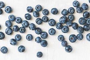 Fresh ripe blueberries over white