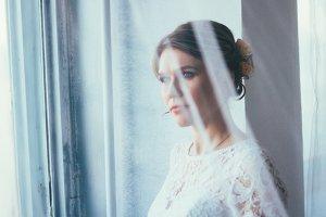 portrait of a bride near a window st