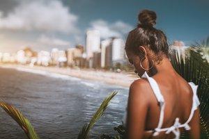 Rear view of black girl, coastline