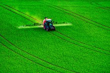 Farm machinery spraying insecticide by  in Nature