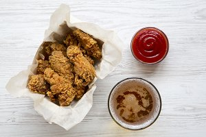 Freshly fried chicken wings with red