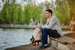 Man with a bouquet of flowers waitin