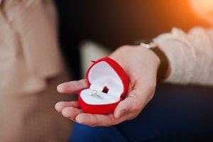Marriage proposal. Man hold engageme