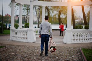 Marriage proposal. Man with boquet o