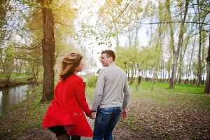 Couple in love running on a park pat