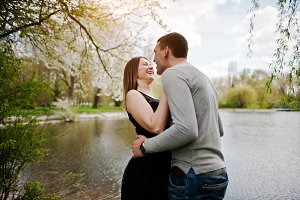 Young couple in love outdoor. Laugh