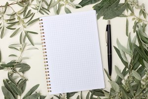 blank notebook with black handle