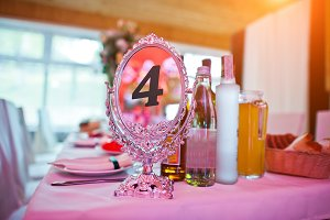 Guests wedding table with sign of nu