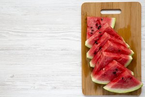 Sliced watermelon on bamboo board