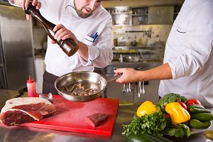 Two chefs cook together