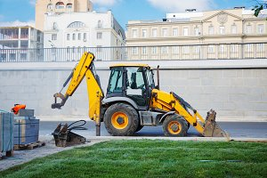 Excavator at the road construction i