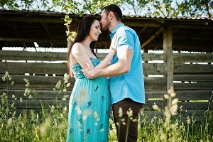 Happy pregnant couple at turquoise d