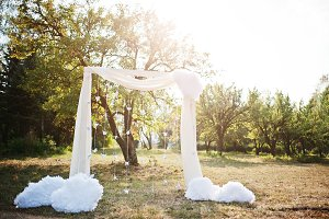 White decor arch for the ceremony at