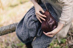small leather handbag in female hand
