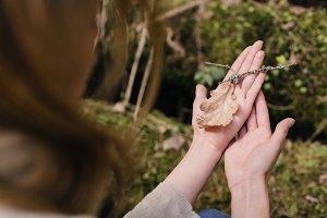 oak leaf in female hands