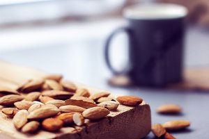 scattered almonds and mug