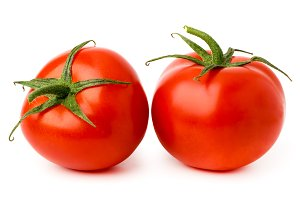 Two ripe tomatoes on a white